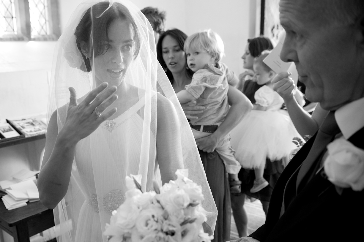 bride signs to father in vestry black & white wedding photography Hampshire
