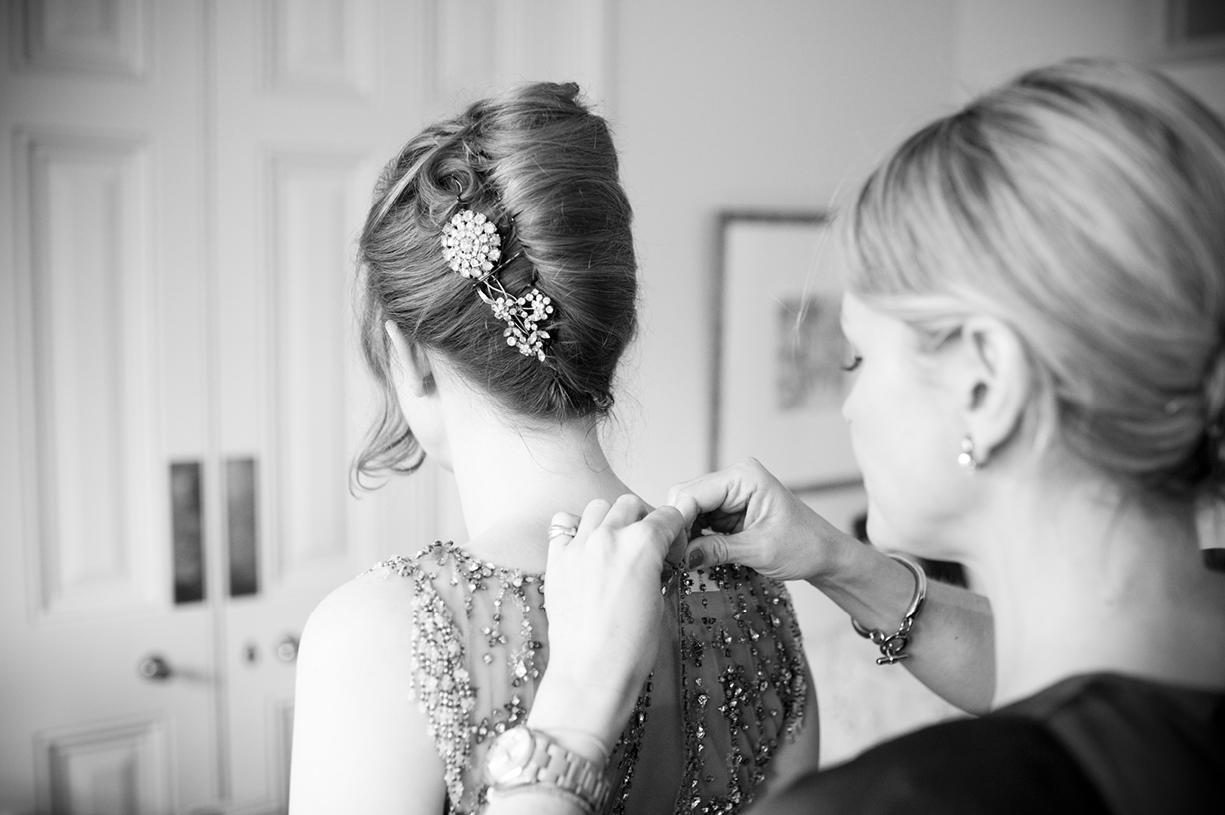 bridesmaid does up vintage Jenny Packham dress beautiful black & white wedding photography preparations London spring wedding
