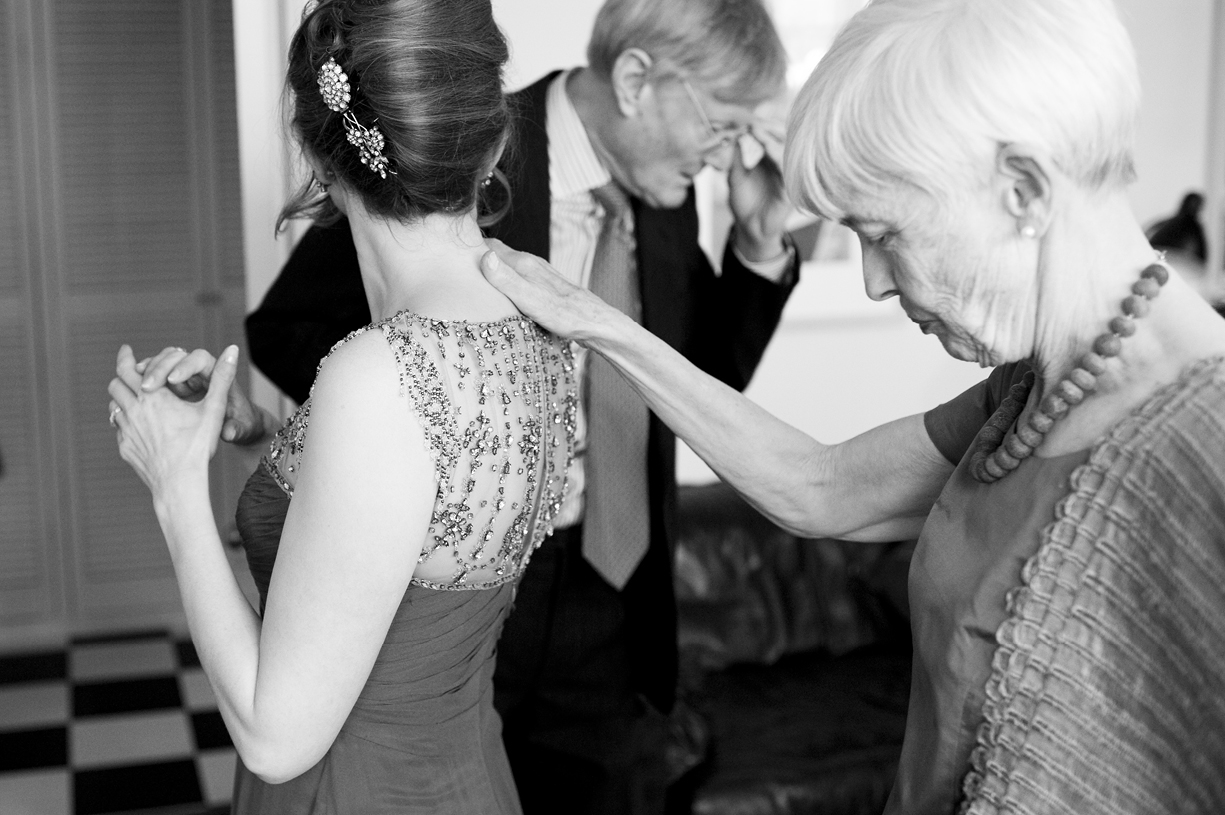 mother of the bride reassures bride in vintage Jenny Packham black & white wedding photography London Battersea
