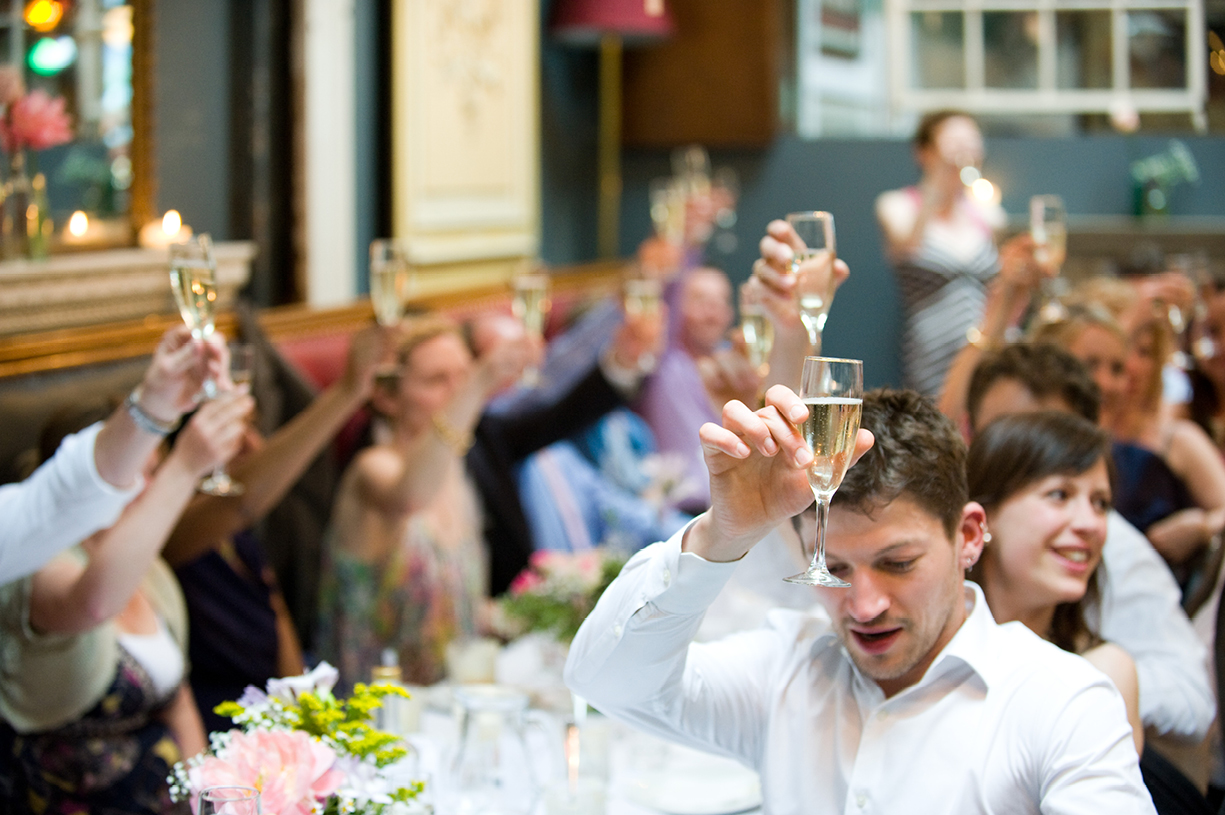 guests toasting bridegroom's speech London spring wedding LASSCO champagne