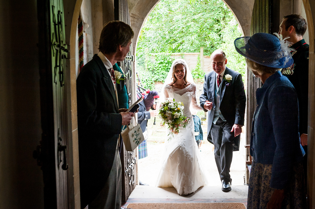 bride on porch Ovington Hampshire summer wedding photography