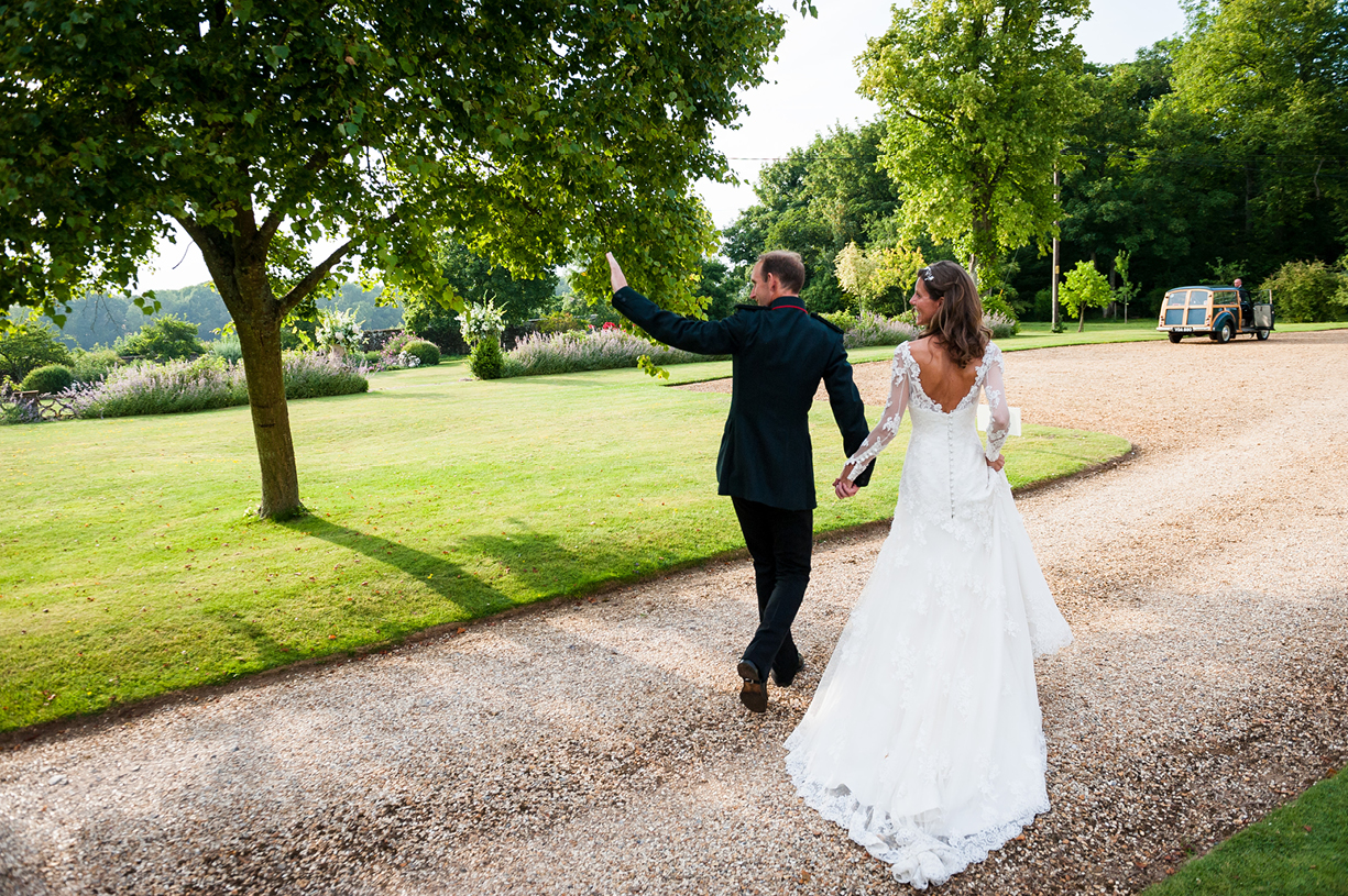 bride & groom leave reception summer wedding photography Ovington Hampshire