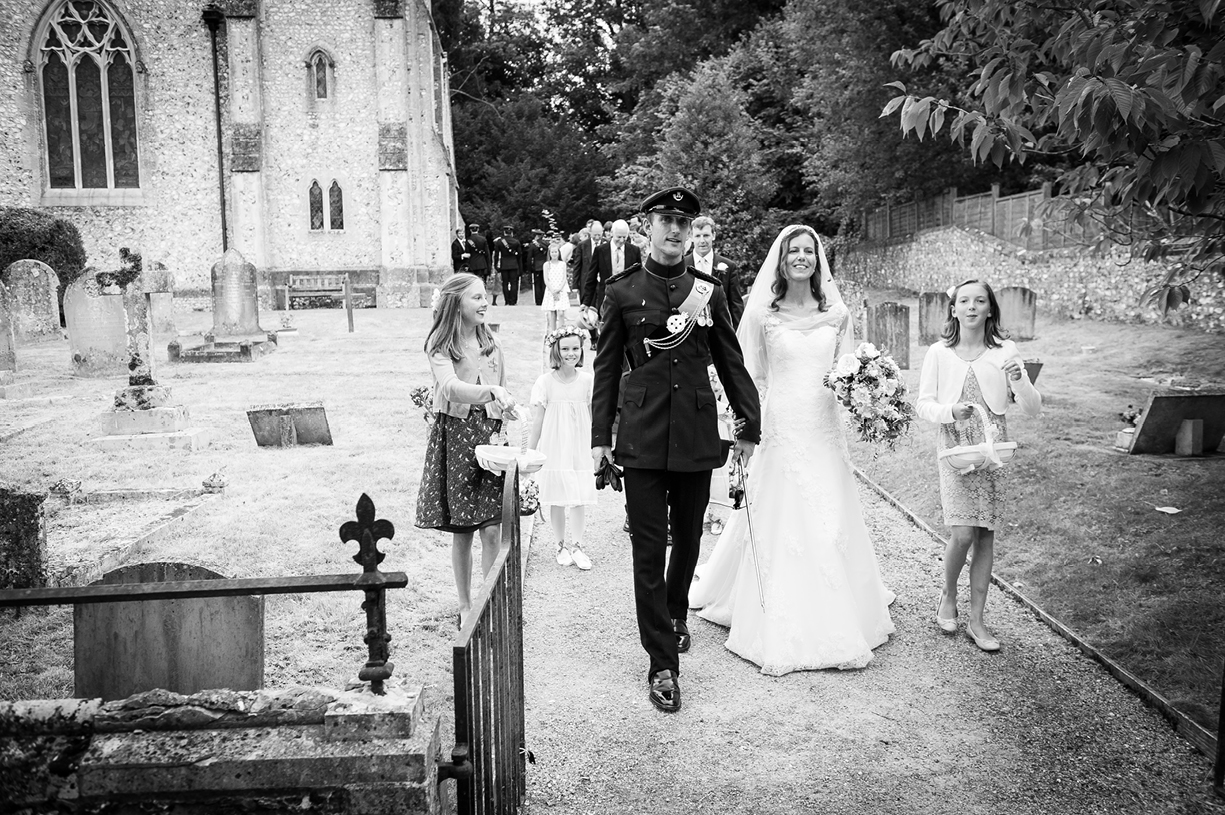 bride & groom leave church black & white wedding photography Ovington Hampshire