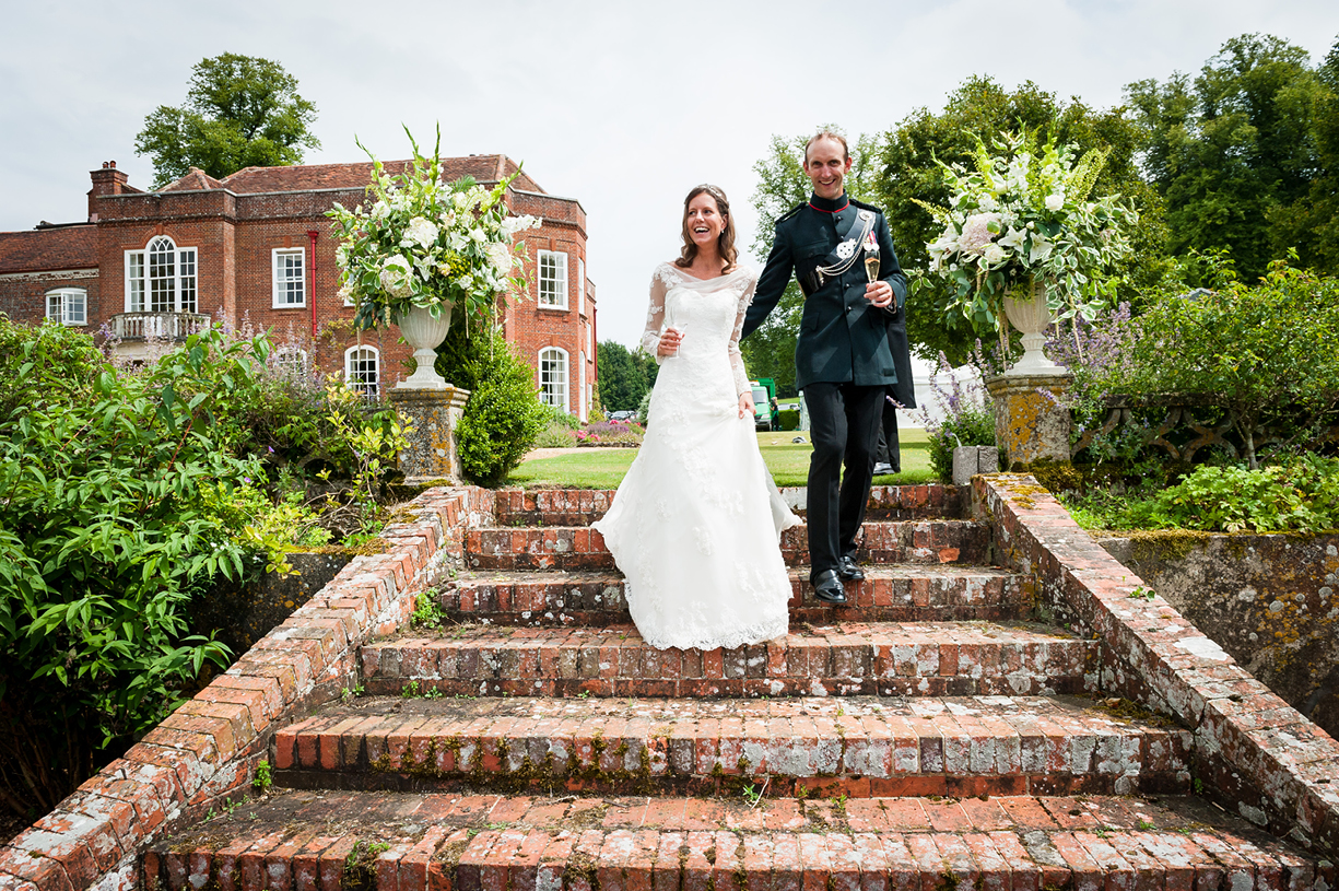 bride & groom enter reception summer garden Ovington Hampshire