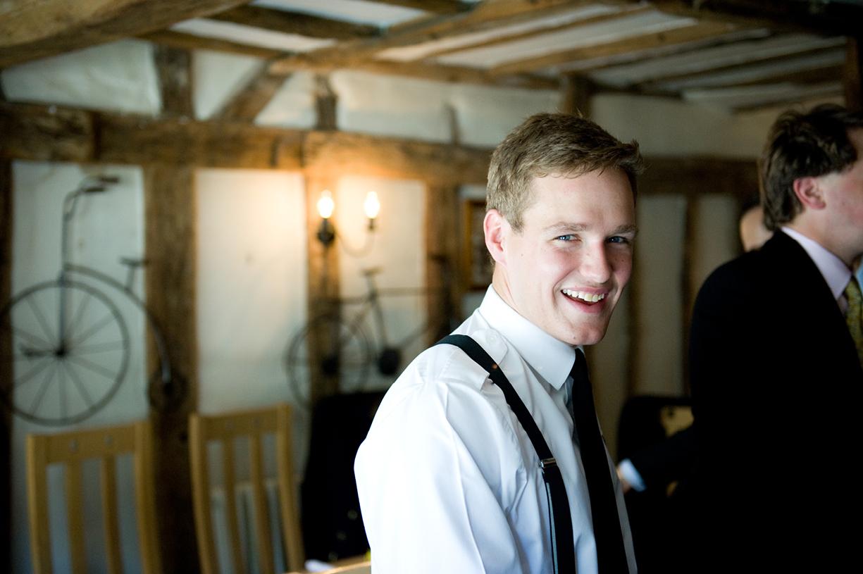 groom laughing in pub before ceremony summer wedding Braintree Essex