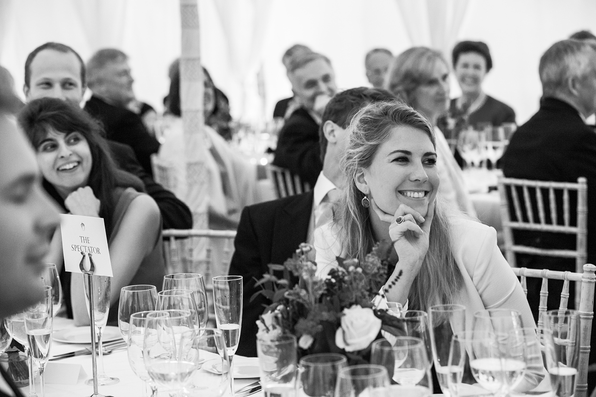 listening to speeches rainy wedding Buckhurst Park East Sussex wedding photography English & Greek