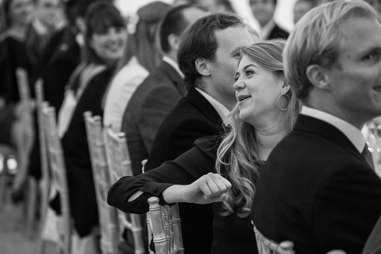 laughing at speeches rainy wedding Buckhurst Park East Sussex wedding photography English & Greek