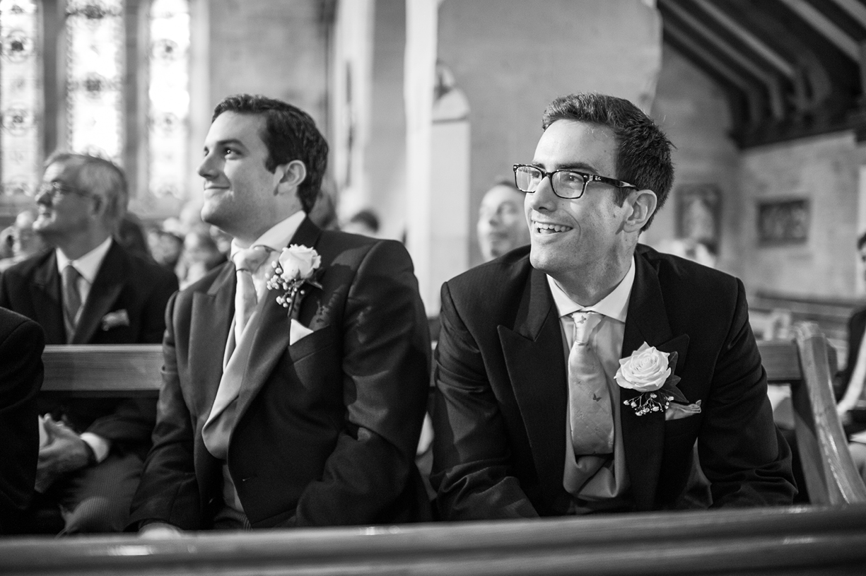 bride's brothers listen in church black & white rainy wedding Buckhurst Park East Sussex wedding photography English & Greek