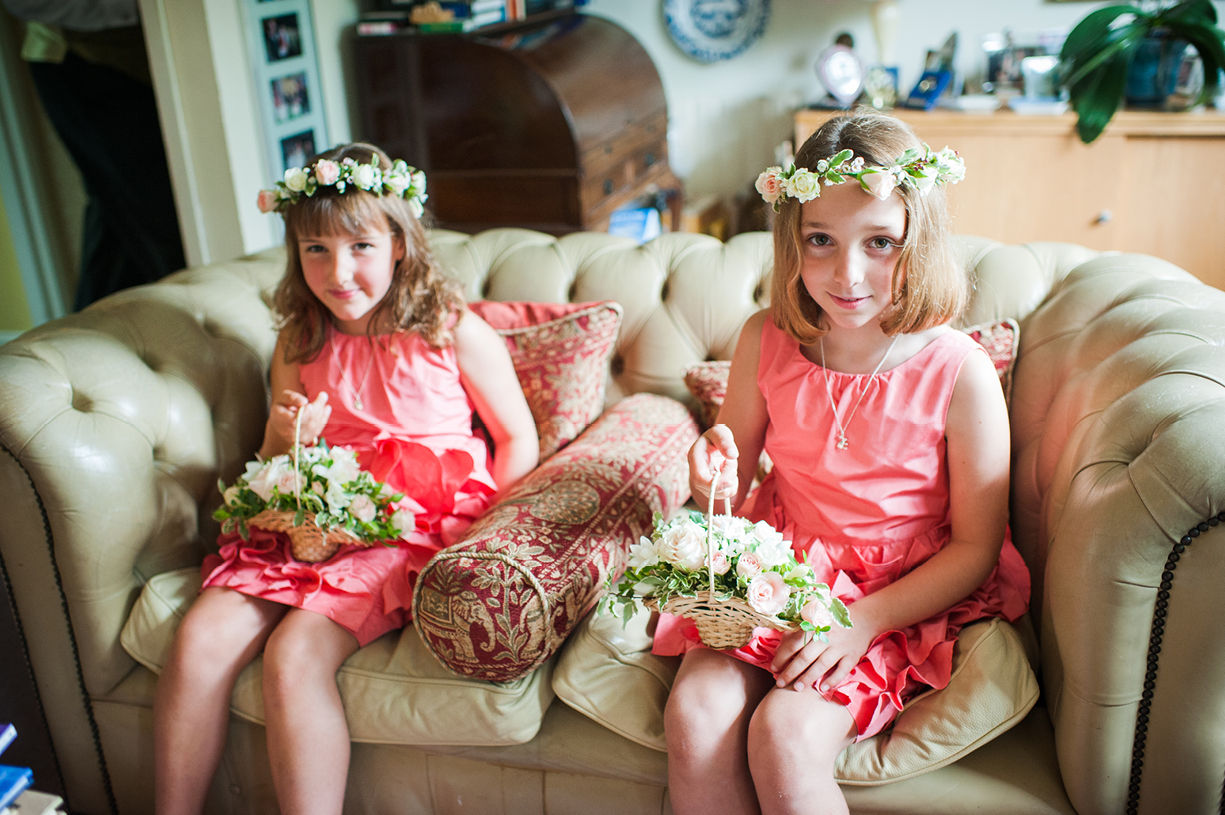 flowergirls wait to leave rainy wedding Buckhurst Park East Sussex wedding photography English & Greek