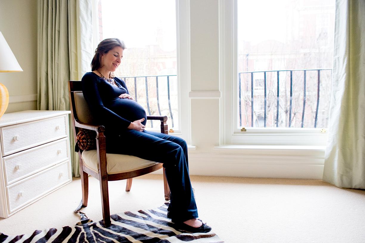 twin pregnancy colour portrait backlit window South London