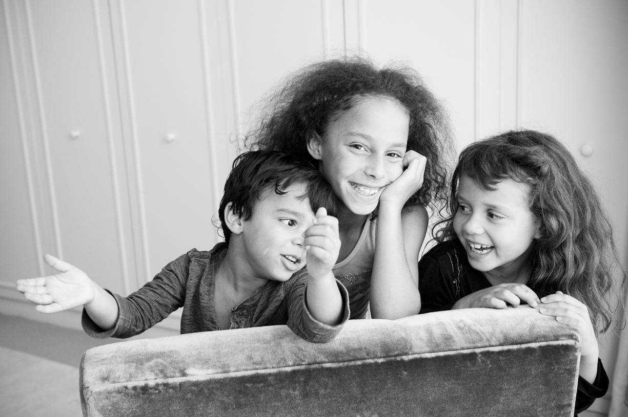 family portrait of three children, black & white laughter, West London