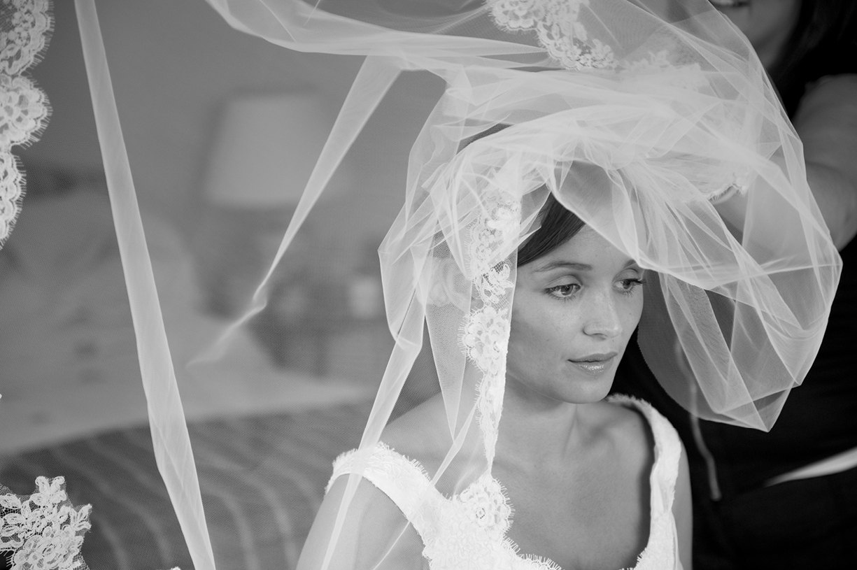 beautiful black & white wedding portrait of bride getting her veil on in Oxfordshire