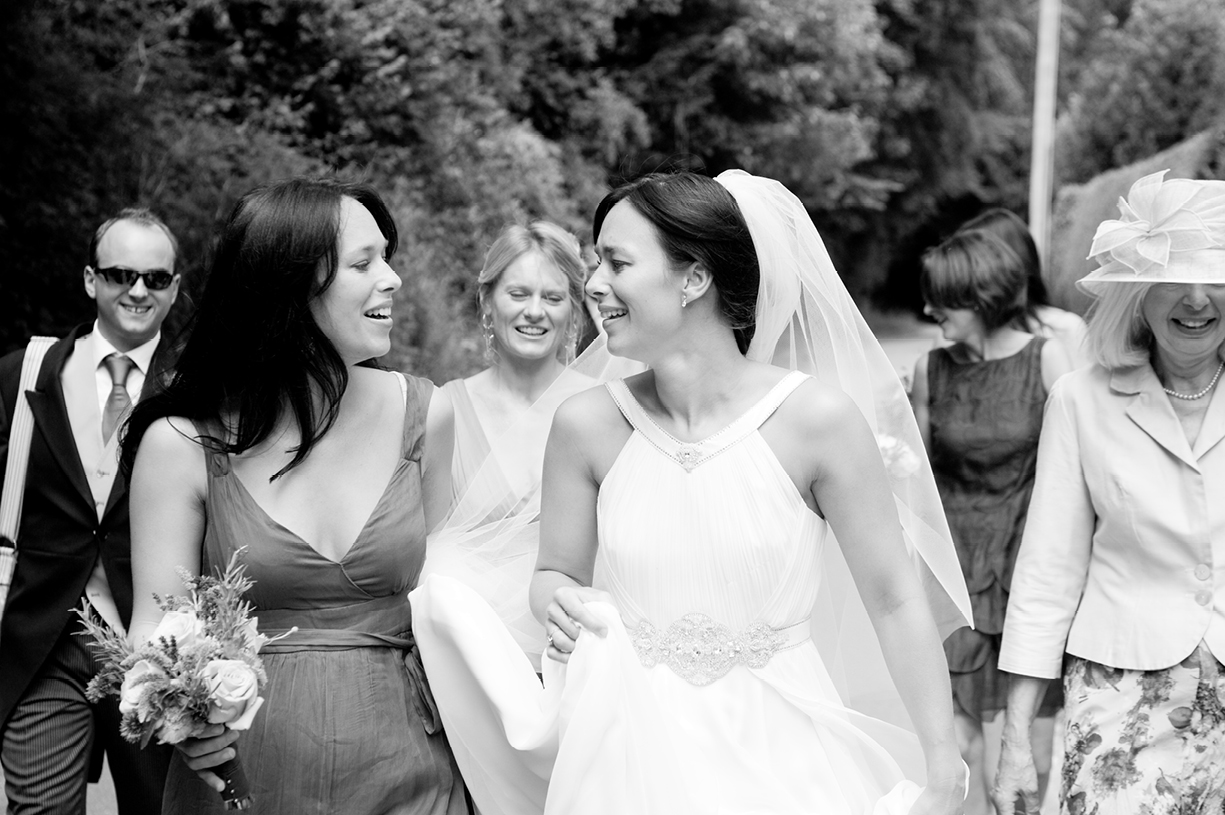 bride and twin sister going to church black & white wedding photograph St Mary's Alresford Hampshire wedding photography