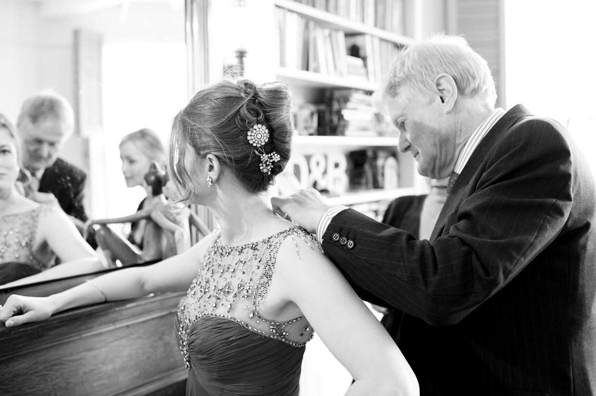 father of the bride secures vintage Jenny Packham dress black & white wedding photography London