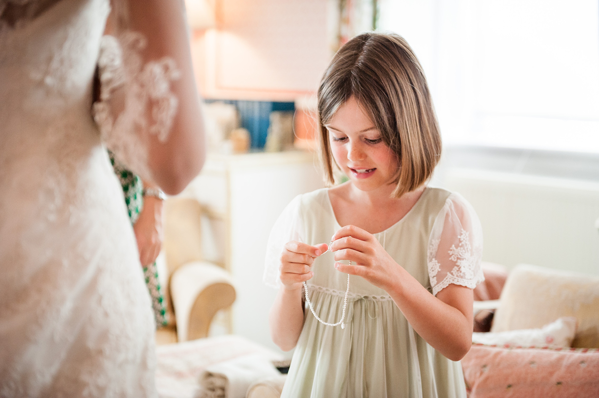 bridesmaid receives gift Philippa Lepley summer wedding photography Ovington Hampshire