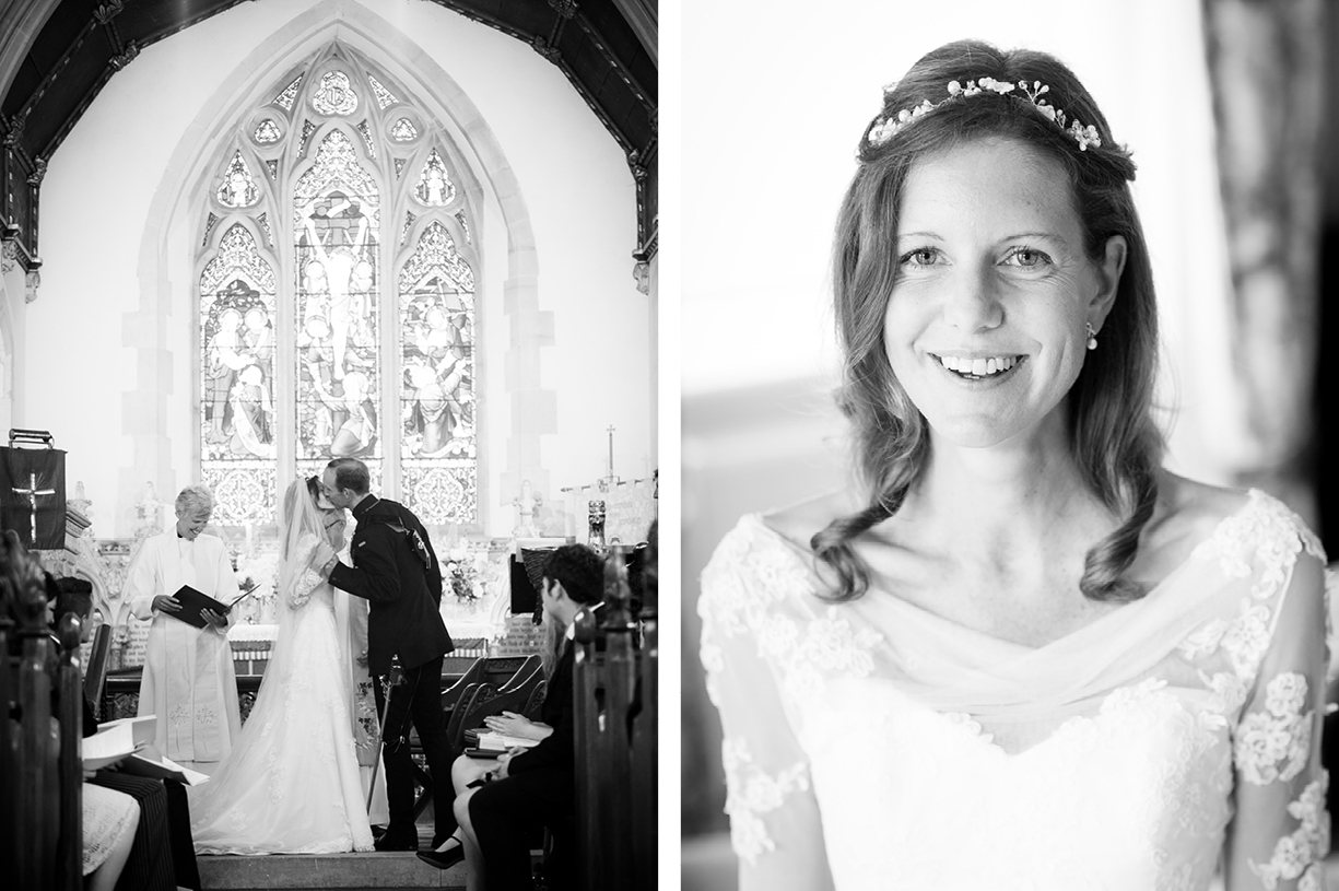 smiling happy bride couple kiss at altar Ovington Hampshire summer black & white wedding photography