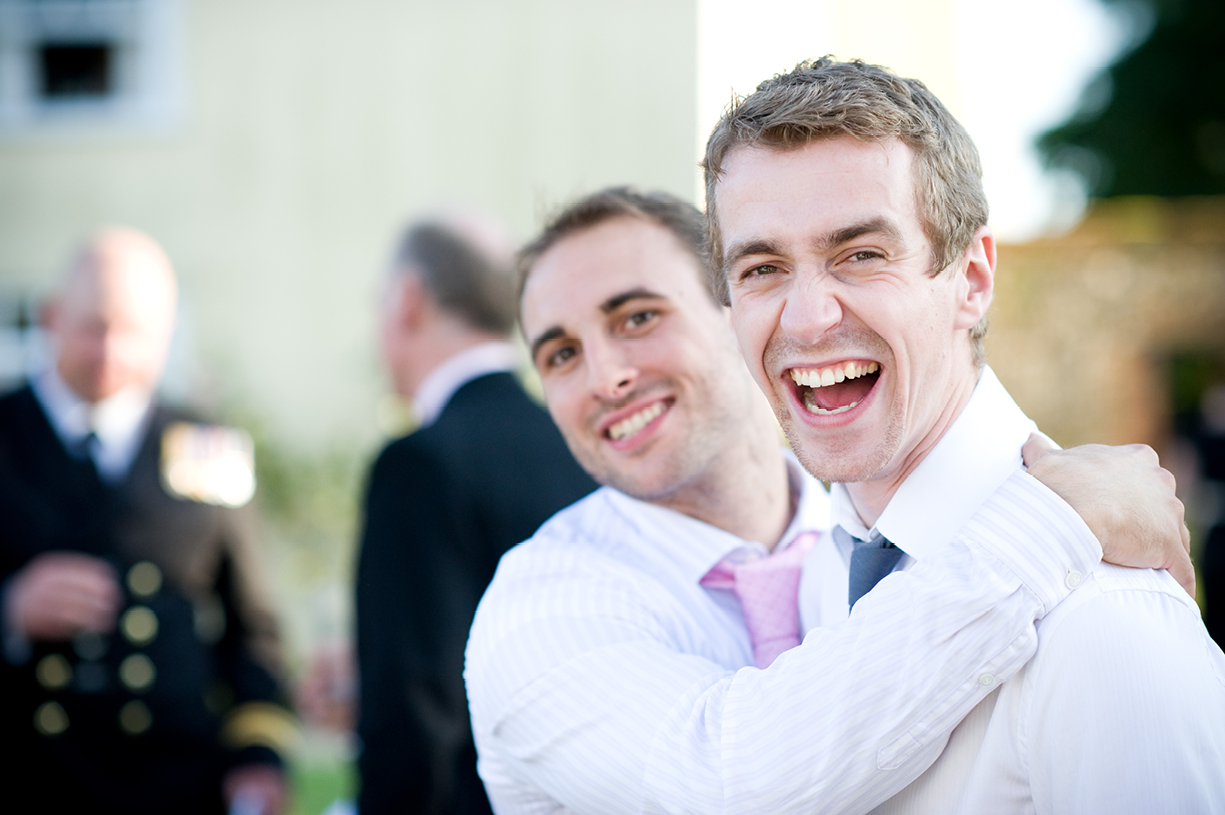 laughing guests summer wedding photography Braintree Essex