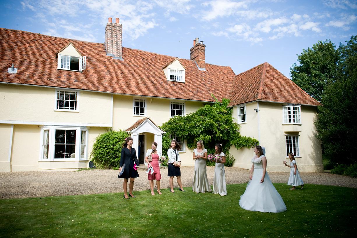 Philippa Lepley wedding dress bridal party assembles outside house sunny summer wedding photography Braintree Essex