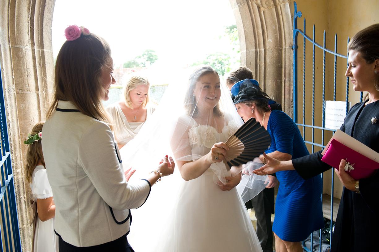Philippa Lepley wedding dress bride and bridesmaids in porch hot summer wedding Braintree Essex