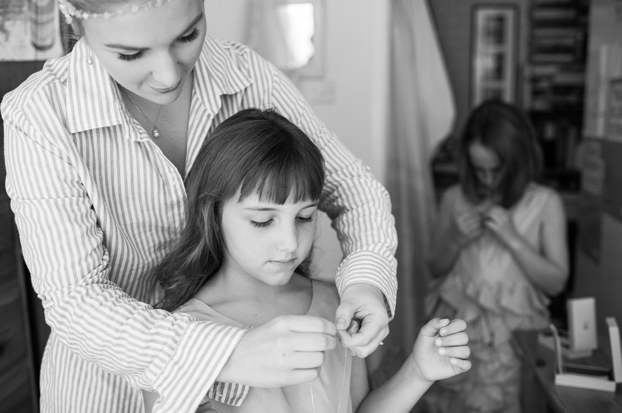 bride gives flowergirl necklack gifts rainy wedding Buckhurst Park East Sussex wedding photography English & Greek