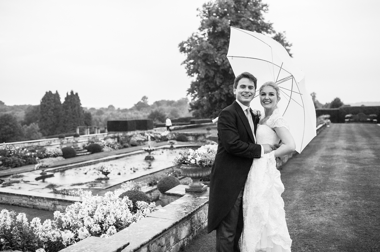 couple portrait black & white rainy wedding Buckhurst Park East Sussex wedding photography English & Greek