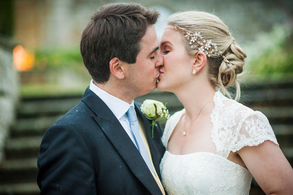 couple portrait kissing rainy wedding Buckhurst Park East Sussex wedding photography English & Greek