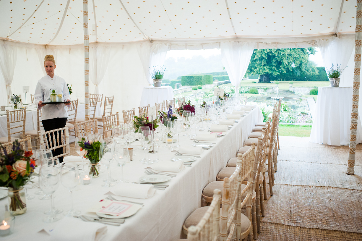 details of setting tables marquee rainy wedding Buckhurst Park East Sussex wedding photography English & Greek