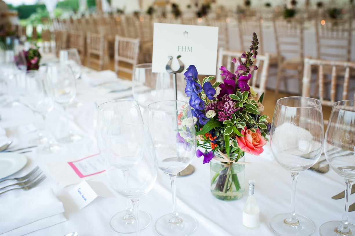 details of flowers tables marquee rainy wedding Buckhurst Park East Sussex wedding photography English & Greek