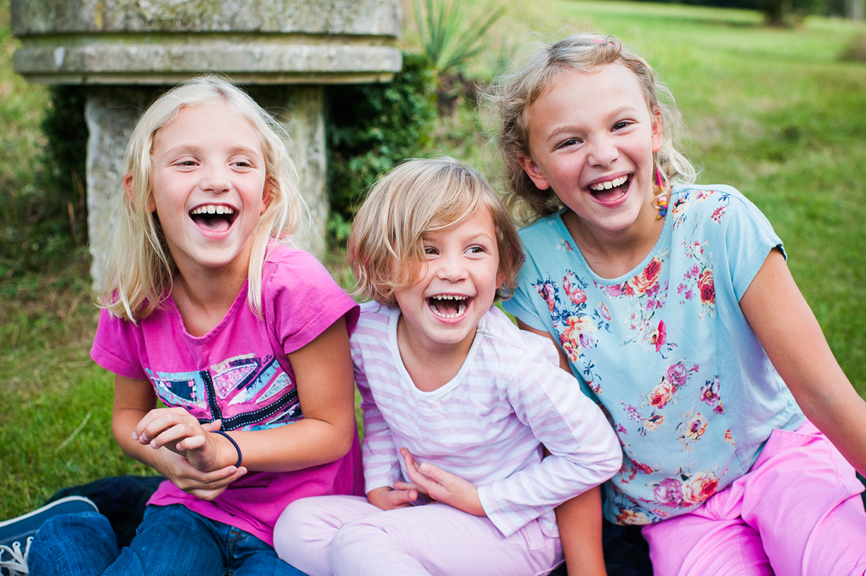 colour portrait three girls laughing in Hampshire in Spring