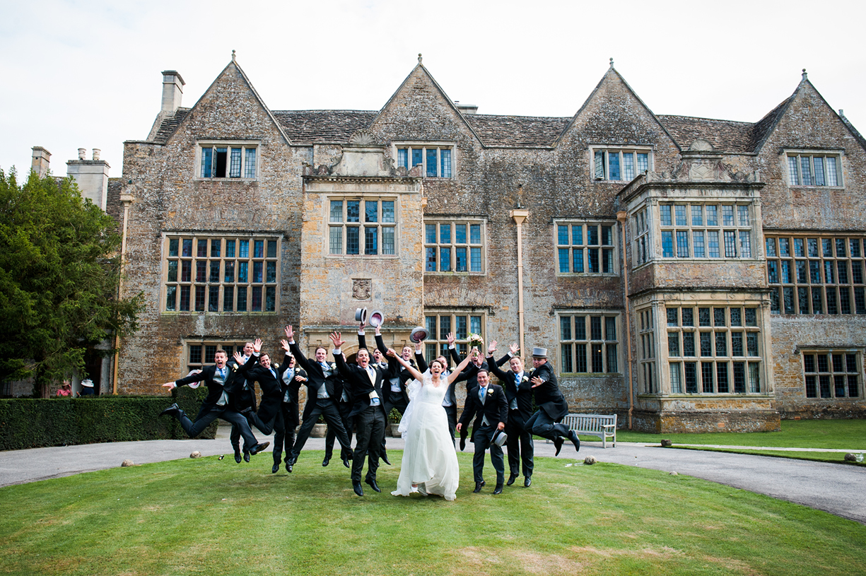 jumping bride, groom and ushers, summer wedding at North Cadbury Court in Somerset