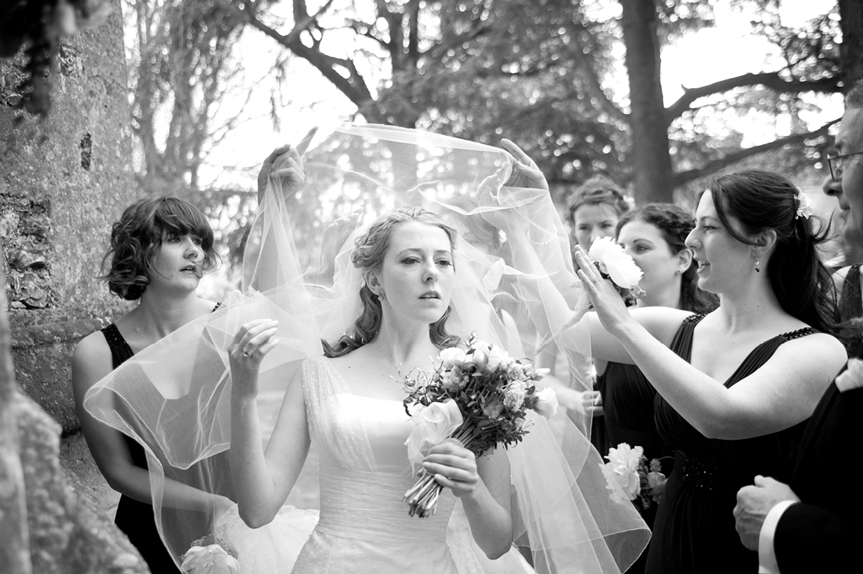 beautiful black & white wedding portrait of brides and her maids of honour with veil in Hampshire