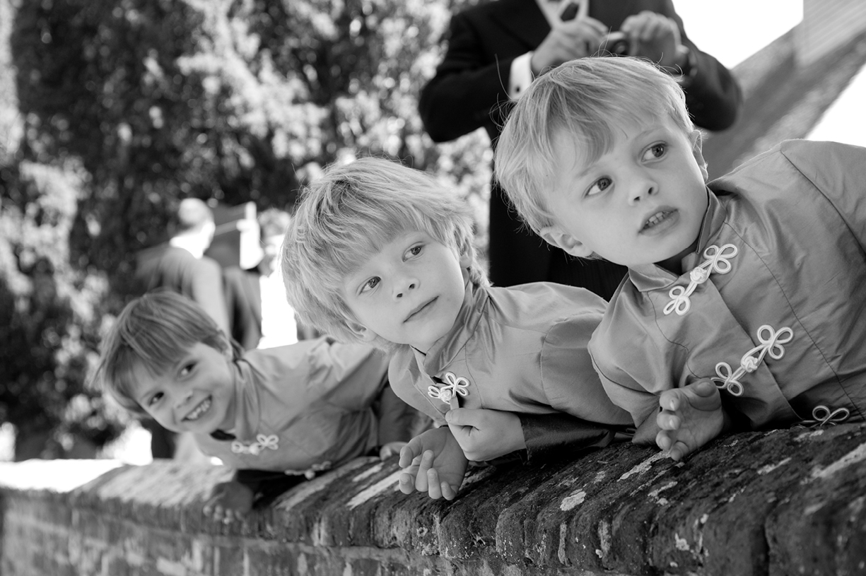 young pageboys wait for bride to arrive at Dummer church in summer