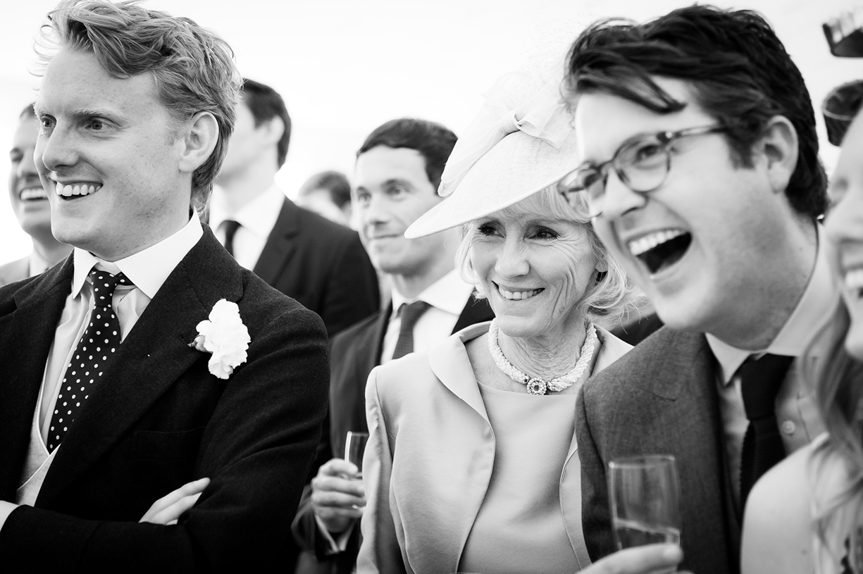 family laughing at speeches spring wedding in Chilton Candover, Hampshire